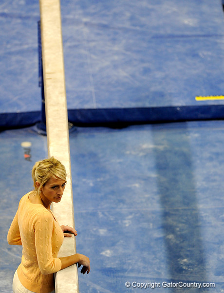 (Casey Brooke Lawson / Gator Country) UF gymnastics Head Coach Rhonda Faehn leans on the beam during the Gators victory over the Oklahoma Sooners in Gainesville, Fla., on January 9, 2009.