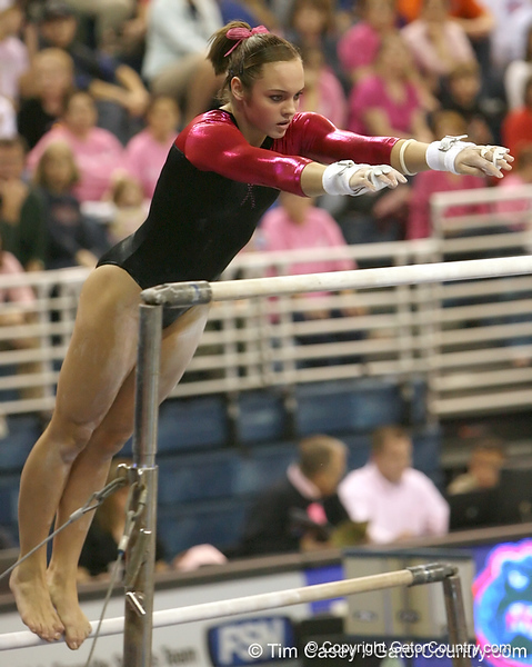 photo by Tim Casey<br /> <br /> Florida sophomore Alicia Goodwin earns a 9.85 on the bars during the Gators' 195.925-193.850 win against the Kentucky Wildcats on Friday, January 30, 2009 at the Stephen C. O'Connell Center in Gainesville, Fla.