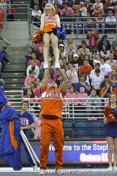 photo by Tim Casey<br /> <br /> Florida cheerleaders perform before the Gators' 195.925-193.850 win against the Kentucky Wildcats on Friday, January 30, 2009 at the Stephen C. O'Connell Center in Gainesville, Fla.