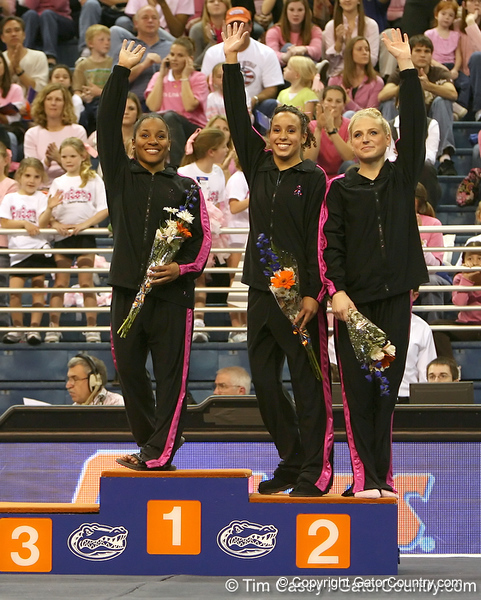 photo by Tim Casey<br /> <br /> Winners from the bars wave during the awards presentation after the Gators' 195.925-193.850 win against the Kentucky Wildcats on Friday, January 30, 2009 at the Stephen C. O'Connell Center in Gainesville, Fla.