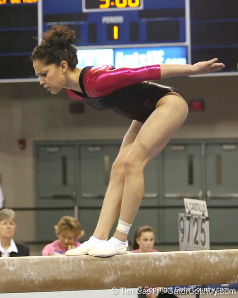 photo by Tim Casey<br /> <br /> Florida junior Amanda Castillo earns a 8.725 on the beam during the Gators' 195.925-193.850 win against the Kentucky Wildcats on Friday, January 30, 2009 at the Stephen C. O'Connell Center in Gainesville, Fla.