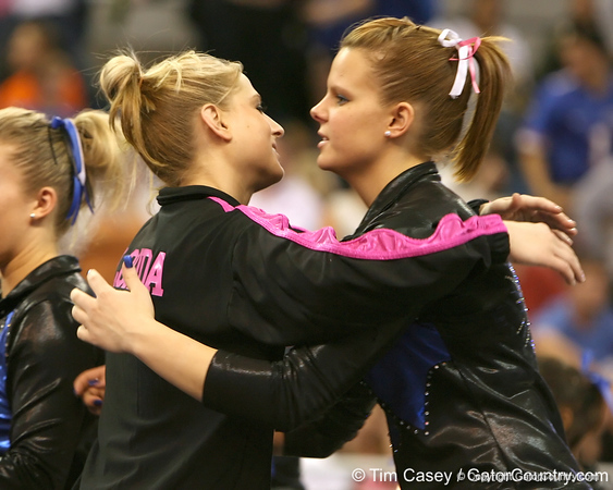 photo by Tim Casey<br /> <br /> Corey Hartung hugs a competitor after the Gators' 195.925-193.850 win against the Kentucky Wildcats on Friday, January 30, 2009 at the Stephen C. O'Connell Center in Gainesville, Fla.