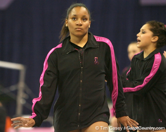 photo by Tim Casey<br /> <br /> Florida junior Melanie Sinclair dances as Maranda Smith earns a 9.85 on the floor exercise during the Gators' 195.925-193.850 win against the Kentucky Wildcats on Friday, January 30, 2009 at the Stephen C. O'Connell Center in Gainesville, Fla.