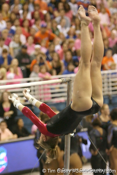 photo by Tim Casey<br /> <br /> Florida senior Corey Hartung earns a 9.9 on the bars during the Gators' 195.925-193.850 win against the Kentucky Wildcats on Friday, January 30, 2009 at the Stephen C. O'Connell Center in Gainesville, Fla.