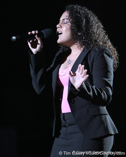 photo by Tim Casey<br /> <br /> Brittany Holmes sings the national anthem before the Gators' 195.925-193.850 win against the Kentucky Wildcats on Friday, January 30, 2009 at the Stephen C. O'Connell Center in Gainesville, Fla.
