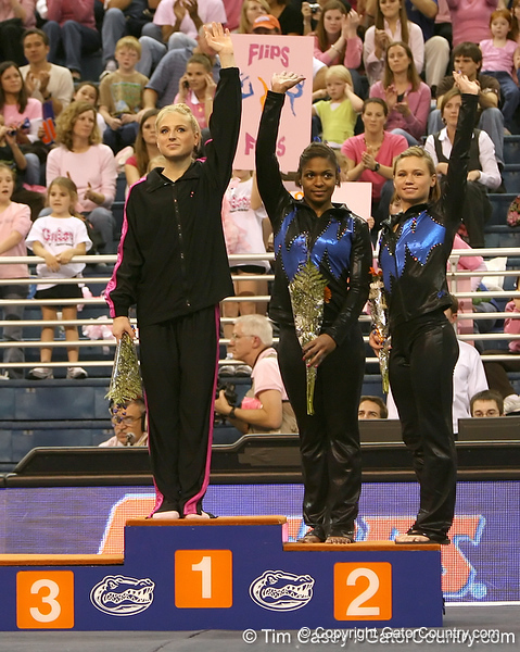 photo by Tim Casey<br /> <br /> Winners from the balance beam wave during the awards presentation after the Gators' 195.925-193.850 win against the Kentucky Wildcats on Friday, January 30, 2009 at the Stephen C. O'Connell Center in Gainesville, Fla.