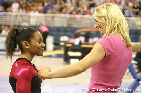 photo by Tim Casey<br /> <br /> Florida junior Melanie Sinclair talks with coach Rhonda Faehn during the Gators' 195.925-193.850 win against the Kentucky Wildcats on Friday, January 30, 2009 at the Stephen C. O'Connell Center in Gainesville, Fla.