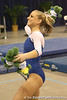 photo by Tim Casey<br /> <br /> Florida senior Corey Hartung throws stuffed alligators to the crowd during the No. 1-ranked Gators' 196.50-196.25 win against the No. 4-ranked Auburn Tigers on on Friday, January 16, 2009 at the Stephen C. O'Connell Center in Gainesville, Fla.