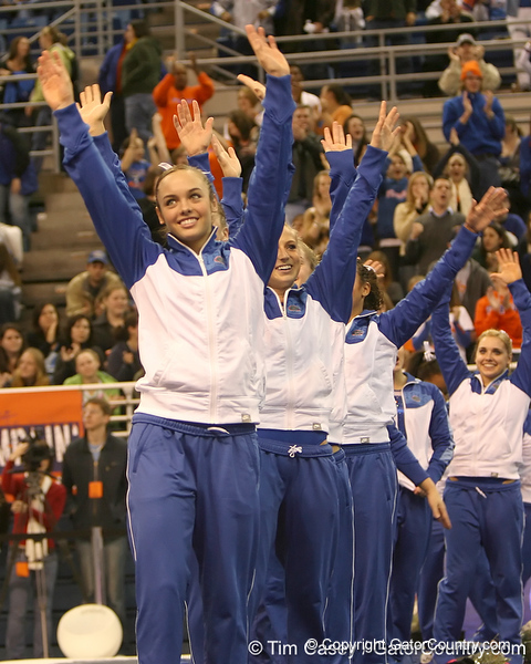 photo by Tim Casey<br /> <br /> The Florida gymnastics team waves during the No. 1-ranked Gators' 196.50-196.25 win against the No. 4-ranked Auburn Tigers on on Friday, January 16, 2009 at the Stephen C. O'Connell Center in Gainesville, Fla.