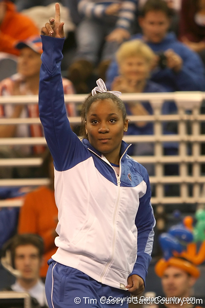 photo by Tim Casey<br /> <br /> Melanie Smith waves after earning third place on the floor exercise during the No. 1-ranked Gators' 196.50-196.25 win against the No. 4-ranked Auburn Tigers on on Friday, January 16, 2009 at the Stephen C. O'Connell Center in Gainesville, Fla.