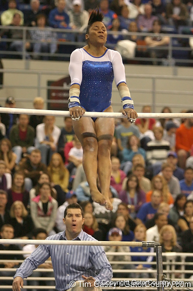 photo by Tim Casey<br /> <br /> Florida junior Melanie Sinclair earns a 9.925 on the uneven bars during the No. 1-ranked Gators' 196.50-196.25 win against the No. 4-ranked Auburn Tigers on on Friday, January 16, 2009 at the Stephen C. O'Connell Center in Gainesville, Fla.