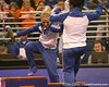 photo by Tim Casey<br /> <br /> Corey Hartung pushes Melanie Sinclair off of the stand during the No. 1-ranked Gators' 196.50-196.25 win against the No. 4-ranked Auburn Tigers on on Friday, January 16, 2009 at the Stephen C. O'Connell Center in Gainesville, Fla.