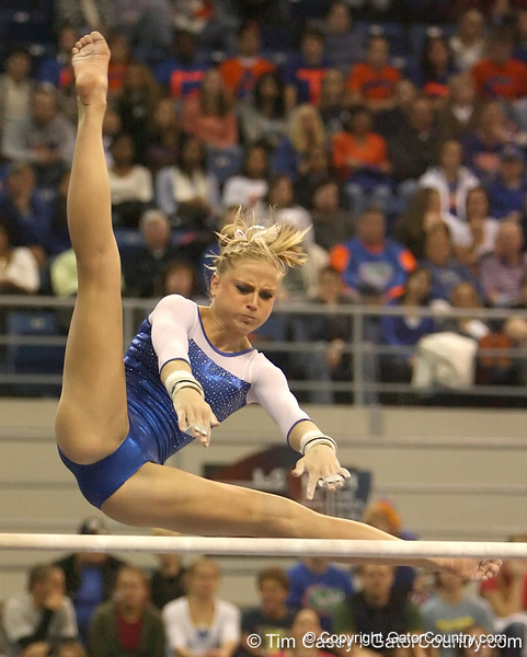 photo by Tim Casey<br /> <br /> Florida junior Corey Hartung earns a 9.925 on the uneven bars during the No. 1-ranked Gators' 196.50-196.25 win against the No. 4-ranked Auburn Tigers on on Friday, January 16, 2009 at the Stephen C. O'Connell Center in Gainesville, Fla.