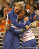 photo by Tim Casey<br /> <br /> Corey Hartung hugs Melanie Sinclair during the No. 1-ranked Gators' 196.50-196.25 win against the No. 4-ranked Auburn Tigers on on Friday, January 16, 2009 at the Stephen C. O'Connell Center in Gainesville, Fla.