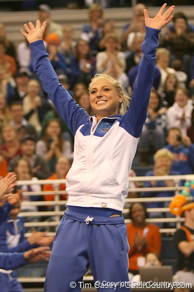 photo by Tim Casey<br /> <br /> Corey Hartung waves after being announced as top performer in all-around competition during the No. 1-ranked Gators' 196.50-196.25 win against the No. 4-ranked Auburn Tigers on on Friday, January 16, 2009 at the Stephen C. O'Connell Center in Gainesville, Fla.