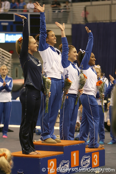 photo by Tim Casey<br /> <br /> Florida junior Maranda Smith is recognized for winning the vault with a score of 9.9 and Nicole Ellis and Melanie Sinclair for finishing in third place with a score of 9.85 during the No. 1-ranked Gators' 196.50-196.25 win against the No. 4-ranked Auburn Tigers on on Friday, January 16, 2009 at the Stephen C. O'Connell Center in Gainesville, Fla.