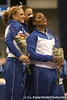 photo by Tim Casey<br /> <br /> Corey Hartung, Alicia Goodwin and Melanie Sinclair are recognized for finishing tied for first place on the uneven bars with a score of 9.925 during the No. 1-ranked Gators' 196.50-196.25 win against the No. 4-ranked Auburn Tigers on on Friday, January 16, 2009 at the Stephen C. O'Connell Center in Gainesville, Fla.