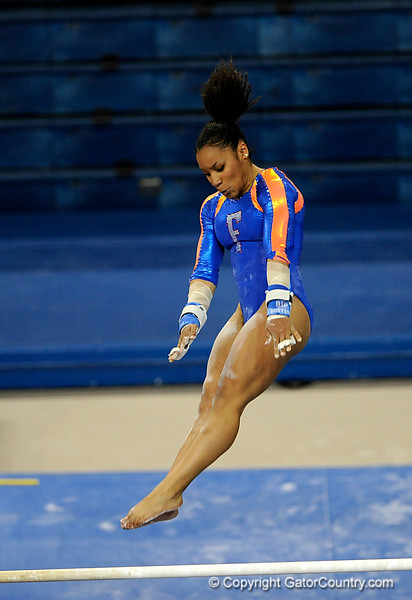 (Casey Brooke Lawson / Gator Country) Melanie Sinclair competes on bars during the Gators gymnastics meet against Alabama on Friday, February 20, 2009.