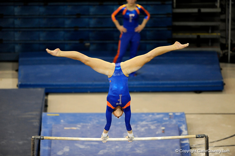 (Casey Brooke Lawson / Gator Country) UF senior Corey Hartung competes on bars during the Gators gymnastics meet against Alabama on Friday, February 20, 2009.