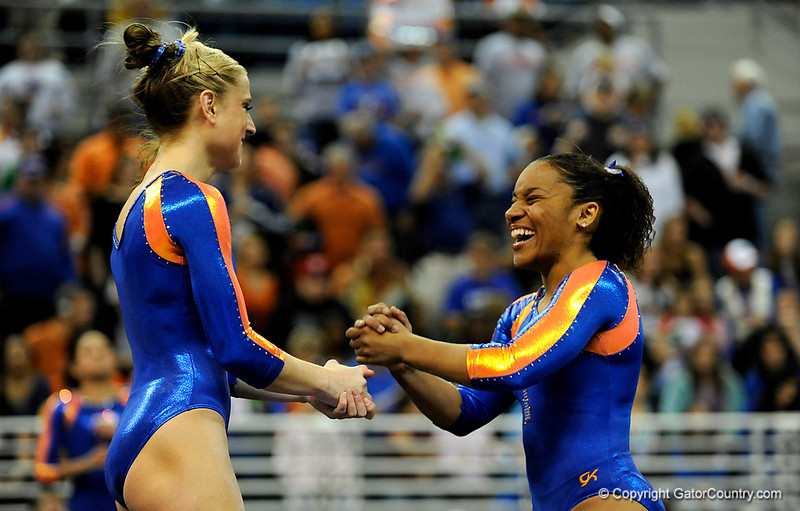 (Casey Brooke Lawson / Gator Country) Corey Hartung and Melanie Sinclair dance together before competing on floor during the Gators gymnastics meet against Alabama on Friday, February 20, 2009.