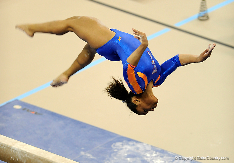 (Casey Brooke Lawson / Gator Country) Melanie Sinclair competes on beam during the Gators gymnastics meet against Alabama on Friday, February 20, 2009.