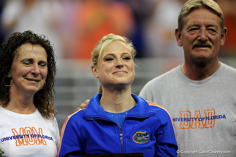 UF senior Corey Hartung stands with her parents during the University of Florida Gators gymnastics meet against the University of Michigan Wolverines on Friday, March 6, 2009 in the Steven C. O'Connell Center. / Gator Country photo by Casey Brooke lawson