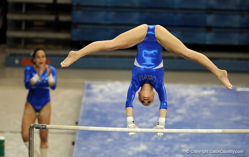 UF senior Corey Hartung competes on the bars during the University of Florida Gators gymnastics meet against the University of Michigan Wolverines on Friday, March 6, 2009 in the Steven C. O'Connell Center. / Gator Country photo by Casey Brooke lawson