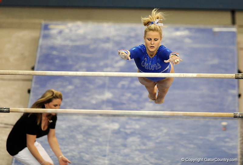 Courtney Gladys competes on the bars during the University of Florida Gators gymnastics meet against the University of Michigan Wolverines on Friday, March 6, 2009 in the Steven C. O'Connell Center. / Gator Country photo by Casey Brooke lawson