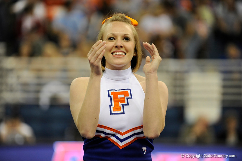 UF cheerleaders warm-up the crowds before the University of Florida Gators gymnastics meet against the University of Michigan Wolverines on Friday, March 6, 2009 in the Steven C. O'Connell Center. / Gator Country photo by Casey Brooke lawson