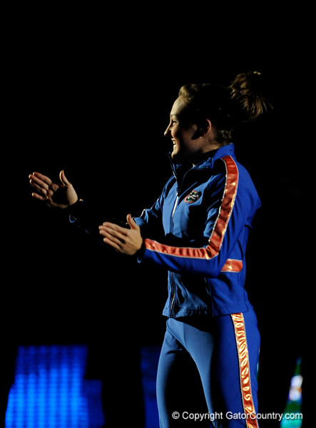 Ashley Kerr claps during the University of Florida Gators gymnastics meet against the University of Michigan Wolverines on Friday, March 6, 2009 in the Steven C. O'Connell Center. / Gator Country photo by Casey Brooke lawson