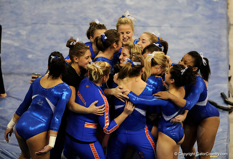 UF senior Corey Hartung gets a team hug after competiting an exhibition on the bars during the University of Florida Gators gymnastics meet against the University of Michigan Wolverines on Friday, March 6, 2009 in the Steven C. O'Connell Center. / Gator Country photo by Casey Brooke lawson