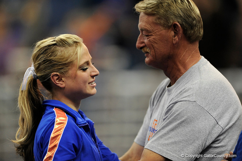 UF senior Corey Hartung embraces her father during the University of Florida Gators gymnastics meet against the University of Michigan Wolverines on Friday, March 6, 2009 in the Steven C. O'Connell Center. / Gator Country photo by Casey Brooke lawson