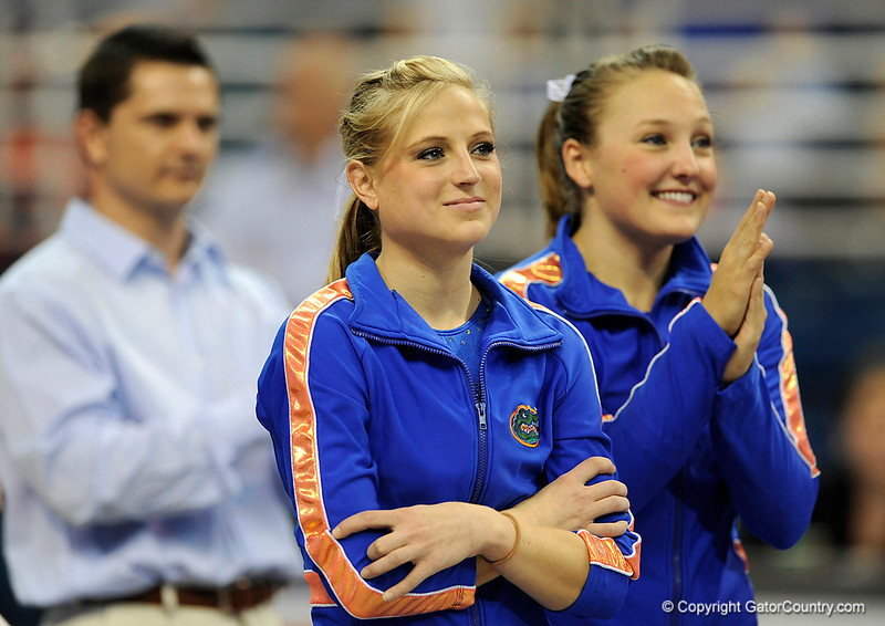 UF senior Corey Hartung watches as a video reel of her years at UF is shown to the crowd during the University of Florida Gators gymnastics meet against the University of Michigan Wolverines on Friday, March 6, 2009 in the Steven C. O'Connell Center. / Gator Country photo by Casey Brooke lawson