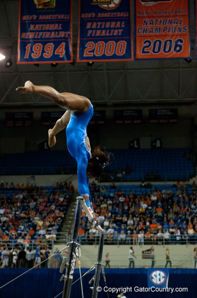 Florida junior Ashanée Dickerson performs on bars during the Gators' 197.525, 196.825  win against the Georgia Bulldogs on Friday, February 24, 2012 at the Stephen C. O'Connell Center in Gainesville, Fla. / Gator Country photo by Saj Guevara