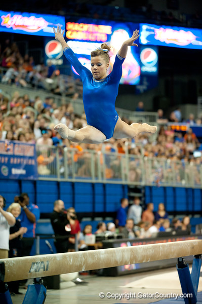 Florida sophomore Mackenzie Caquatto performs an exhibition on beam during the Gators' 197.525, 196.825  win against the Georgia Bulldogs on Friday, February 24, 2012 at the Stephen C. O'Connell Center in Gainesville, Fla. / Gator Country photo by Saj Guevara