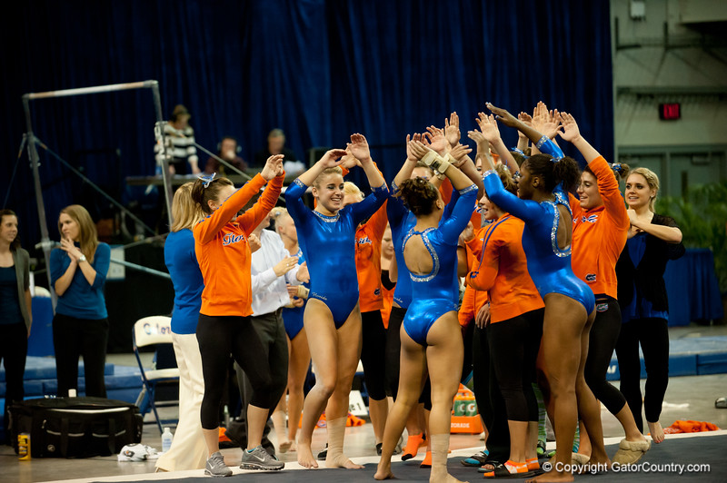 Florida Gators gymnastics team celebrates after Kytra Hunter's floor performance during the Gators' 197.525, 196.825  win against the Georgia Bulldogs on Friday, February 24, 2012 at the Stephen C. O'Connell Center in Gainesville, Fla. / Gator Country photo by Saj Guevara