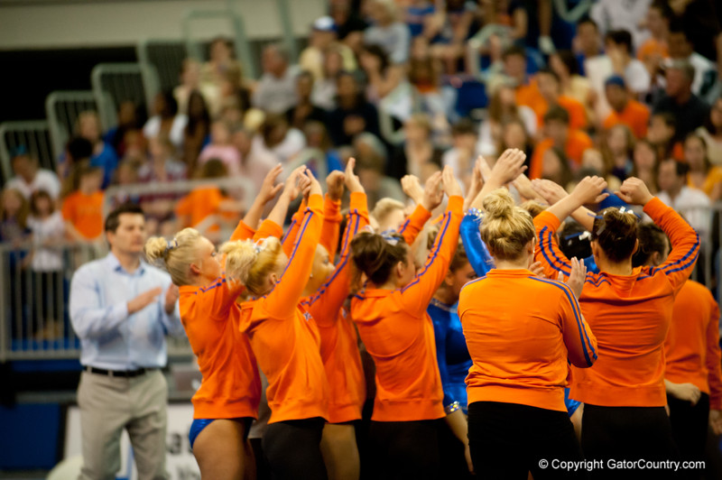 Florida Gators gymnastics team celebrating after Mrarissa King's floor performance during the Gators' 197.525, 196.825  win against the Georgia Bulldogs on Friday, February 24, 2012 at the Stephen C. O'Connell Center in Gainesville, Fla. / Gator Country photo by Saj Guevara