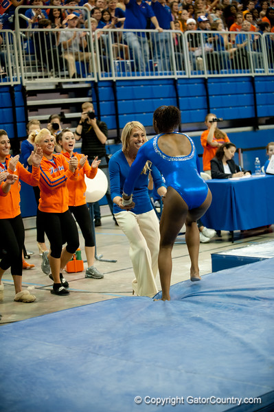 Florida junior Ashanée Dickerson is greeted by her coach after her performance on beam during the Gators' 197.525, 196.825  win against the Georgia Bulldogs on Friday, February 24, 2012 at the Stephen C. O'Connell Center in Gainesville, Fla. / Gator Country photo by Saj Guevara