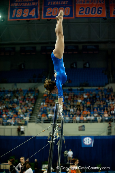 Florida freshman Kiersten Wang performs an exhibition on bars during the Gators' 197.525, 196.825  win against the Georgia Bulldogs on Friday, February 24, 2012 at the Stephen C. O'Connell Center in Gainesville, Fla. / Gator Country photo by Saj Guevara
