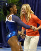 Florida junior Ashanée Dickerson gets congratulated by head coach Rhonda Faehn after performing on the balance beam during the Gators' 196.175-191.875 win against the Illinois-Chicago Flames on Friday, January 13, 2012 at the Stephen C. O'Connell Center in Gainesville, Fla. / Gator Country photo by Tim Casey