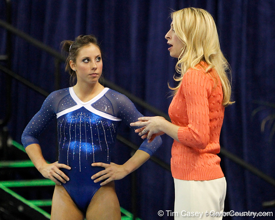 Florida sophomore Alaina Johnson listens to head coach Rhonda Faehn during the Gators' 196.175-191.875 win against the Illinois-Chicago Flames on Friday, January 13, 2012 at the Stephen C. O'Connell Center in Gainesville, Fla. / Gator Country photo by Tim Casey