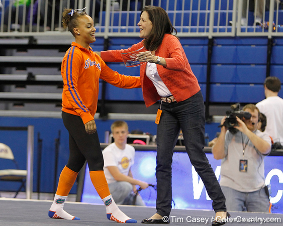 Florida freshman Kytra Hunter receives an award after the Gators' 196.175-191.875 win against the Illinois-Chicago Flames on Friday, January 13, 2012 at the Stephen C. O'Connell Center in Gainesville, Fla. / Gator Country photo by Tim Casey