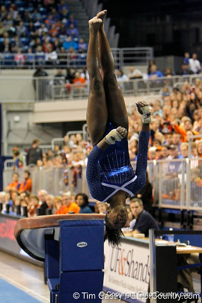 Florida junior Ashanée Dickerson performs on the vault during the Gators' 196.175-191.875 win against the Illinois-Chicago Flames on Friday, January 13, 2012 at the Stephen C. O'Connell Center in Gainesville, Fla. / Gator Country photo by Tim Casey