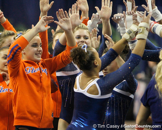 Florida freshman Kytra Hunter is greeted be teammates after performing on the vault during the Gators' 196.175-191.875 win against the Illinois-Chicago Flames on Friday, January 13, 2012 at the Stephen C. O'Connell Center in Gainesville, Fla. / Gator Country photo by Tim Casey
