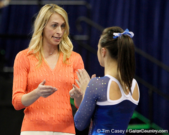 Florida head coach Rhonda Faehn talks with an athlete during the Gators' 196.175-191.875 win against the Illinois-Chicago Flames on Friday, January 13, 2012 at the Stephen C. O'Connell Center in Gainesville, Fla. / Gator Country photo by Tim Casey