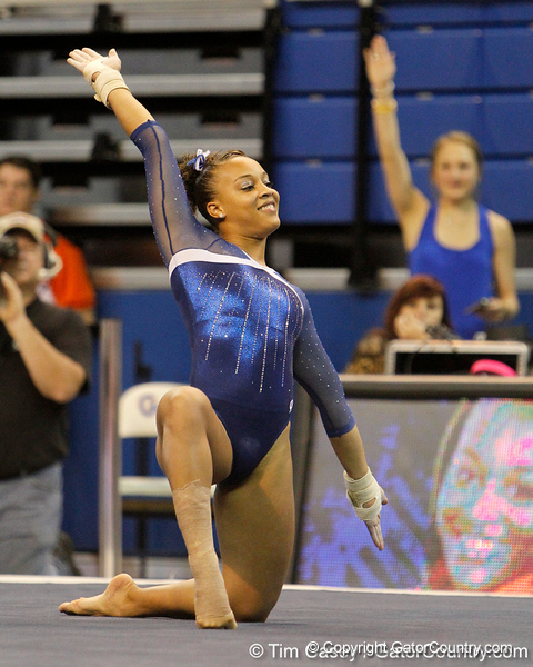 Florida freshman Kytra Hunter does a Gator chomp as part of her floor exercise routine during the Gators' 196.175-191.875 win against the Illinois-Chicago Flames on Friday, January 13, 2012 at the Stephen C. O'Connell Center in Gainesville, Fla. / Gator Country photo by Tim Casey