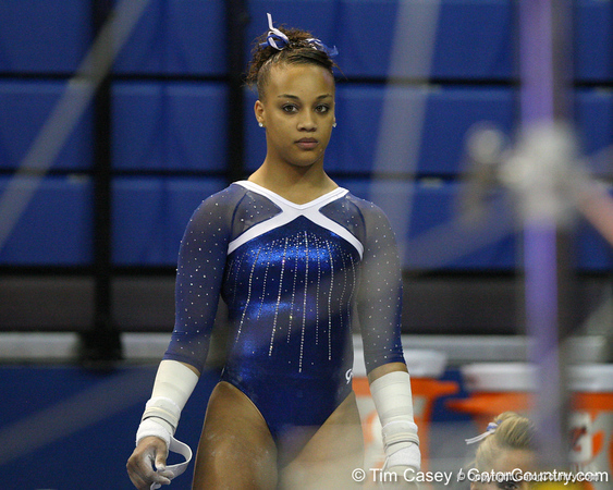 Florida freshman Kytra Hunter waits to perform on the uneven parallel bars during the Gators' 196.175-191.875 win against the Illinois-Chicago Flames on Friday, January 13, 2012 at the Stephen C. O'Connell Center in Gainesville, Fla. / Gator Country photo by Tim Casey