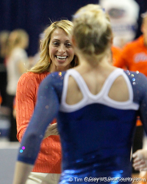 Florida head coach Rhonda Faehn greets an athlete after the vault during the Gators' 196.175-191.875 win against the Illinois-Chicago Flames on Friday, January 13, 2012 at the Stephen C. O'Connell Center in Gainesville, Fla. / Gator Country photo by Tim Casey