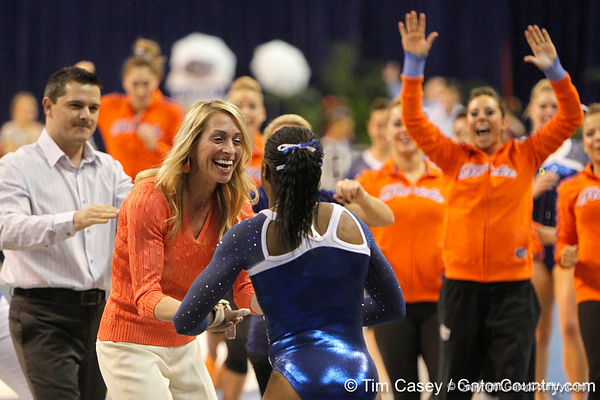 Florida head coach Rhonda Faehn greets junior Ashanée Dickerson after the vault during the Gators' 196.175-191.875 win against the Illinois-Chicago Flames on Friday, January 13, 2012 at the Stephen C. O'Connell Center in Gainesville, Fla. / Gator Country photo by Tim Casey