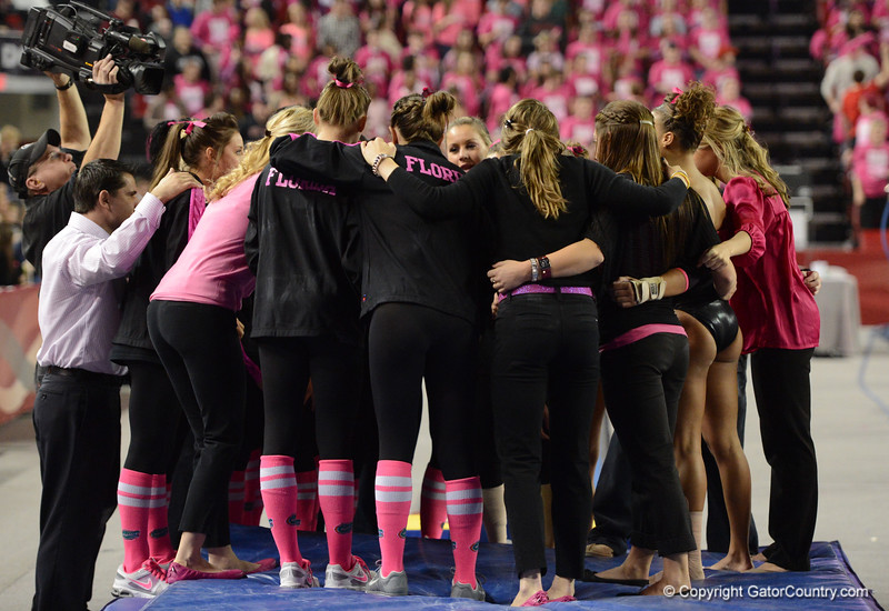 Florida vs Georgia, Feb 16, 2013 - Gator team gathers after posting  team score of 49.475 on Vault
